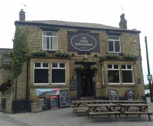 The second pub is The Three Horseshoes, just a few doors down from Woodies. For a very brief period in 2015, the owners changed its name to The Industrialist, but the original name was quickly restored after a public outcry.